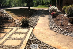 Landscape with stone drainage solution