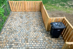 Driveway with cedar fencind and trach enclosure nook